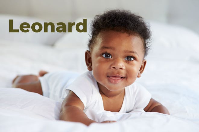 Baby lying on front on bed with head raised. Name Leonard written in text