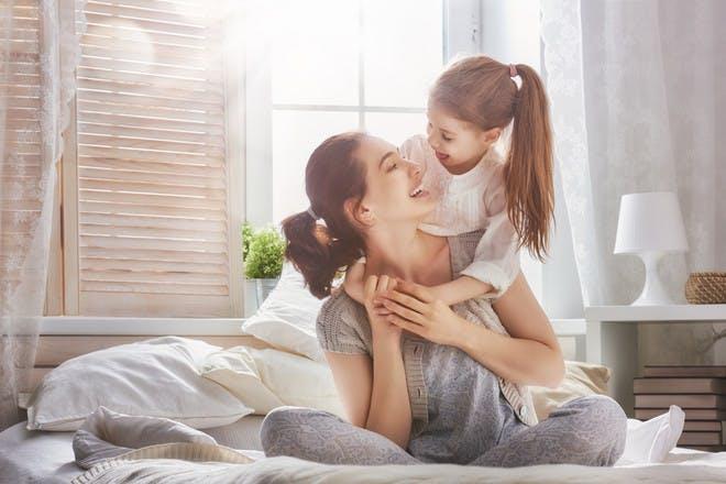 Mum and daughter hugging