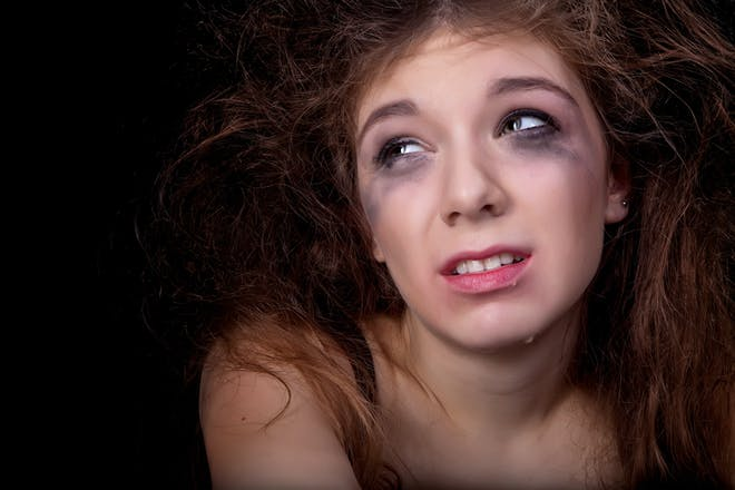 Teen crying with make up running down her face
