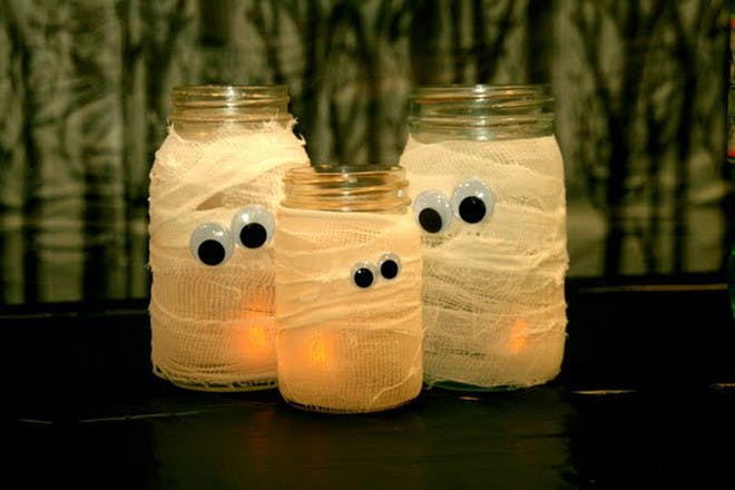 Glass jars turned into Halloween mummies