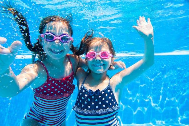 two girls swimming underwater