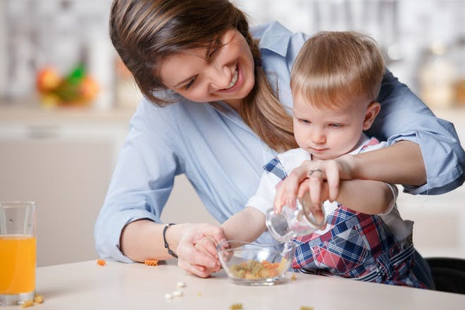 mum playing with son in kitchen