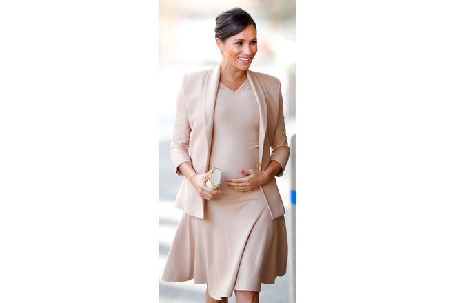 Meghan Markle pregnant in short dress