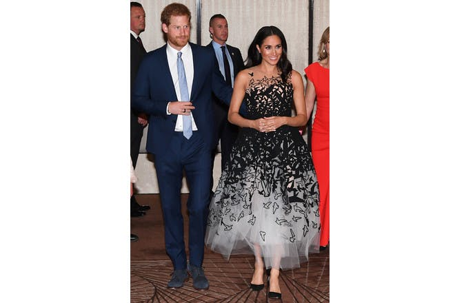 Meghan Markle pregnant in black net bird dress