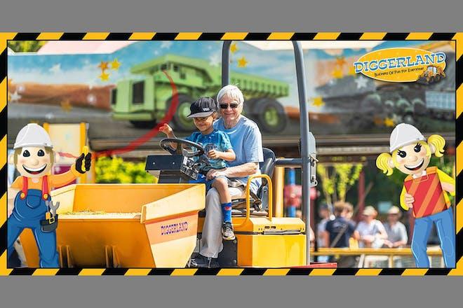 Boy and grandad riding on digger