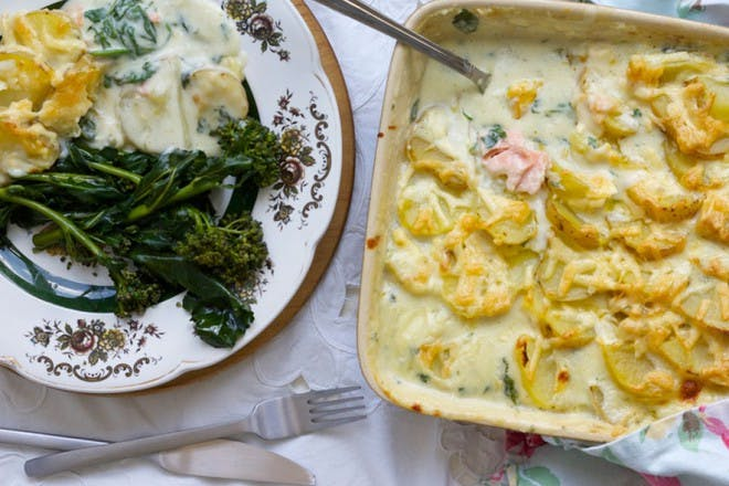fish pie in a dish with vegetables