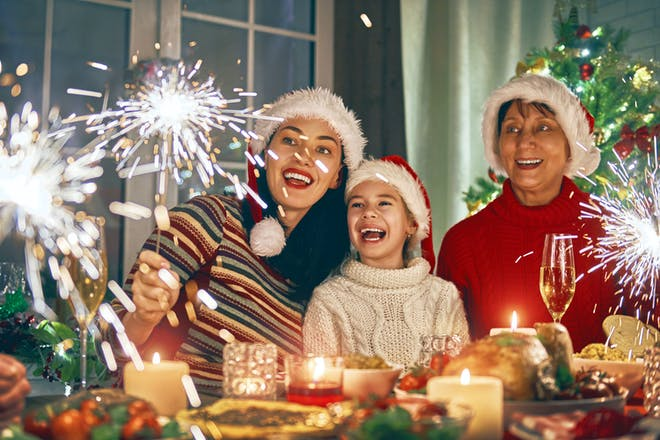 Family enjoying sparklers at a Christmas party