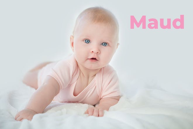 Baby wearing pink baby gro. Name Maud written in text