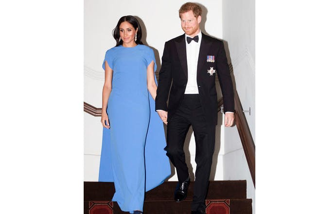 Meghan Markle pregnant in blue dress with cape