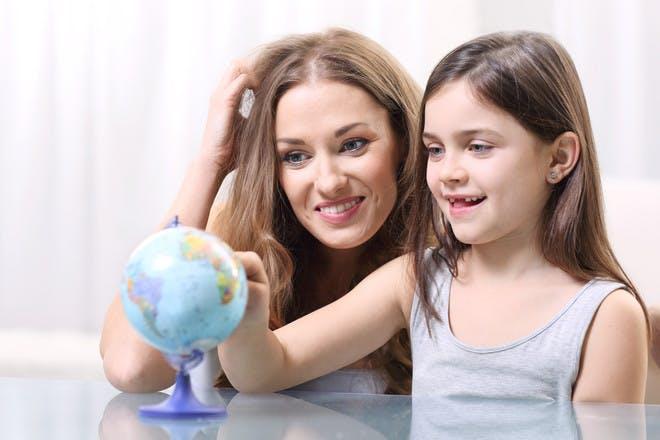 Mum and daughter with mini globe