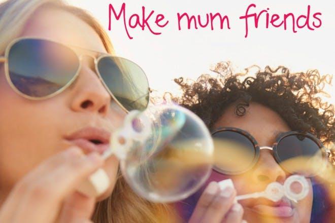 women in sunglasses blowing bubbles