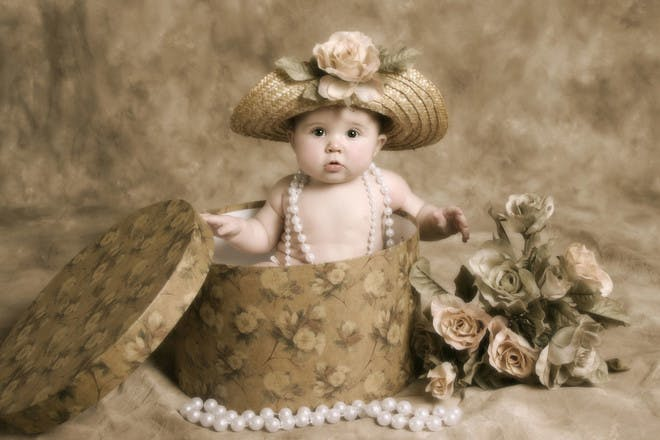 baby in hatbox