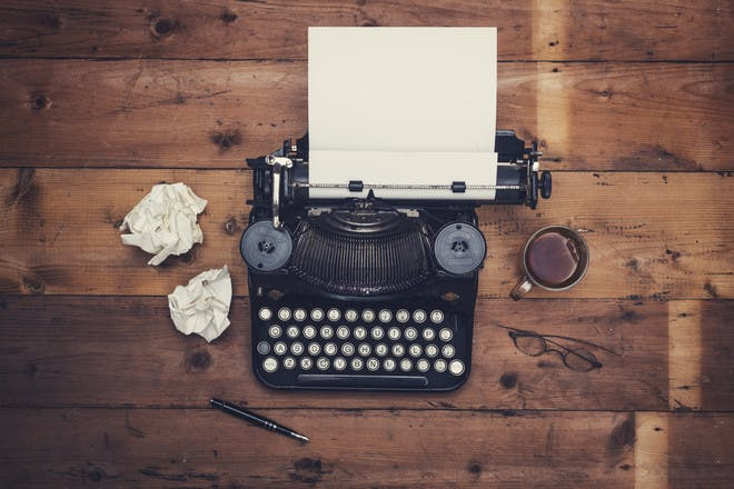 Typewriter on wooden table