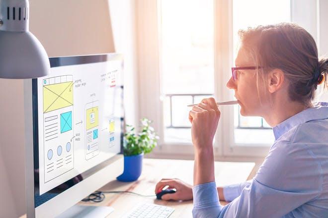 Woman designing website on desktop