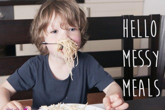 child eating spaghetti