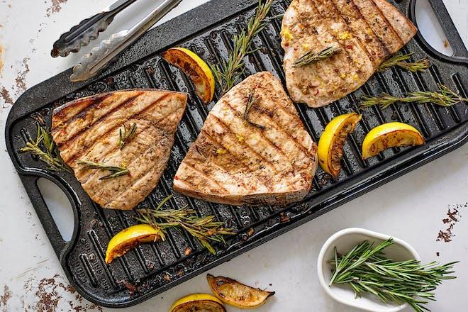 Swordfish steaks on griddle pan