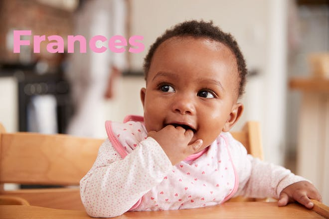 Baby in high chair. Name Frances written in text