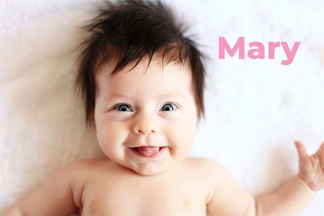 Baby with lots of dark hair smiling. Name Mary written in text