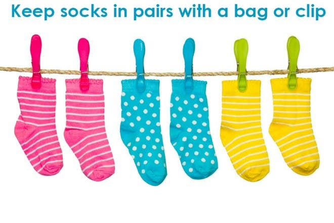 pink blue and yellow socks hanging by pegs on rope