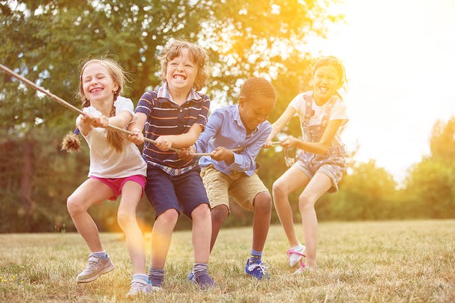 group of children pulling on rope in game of tug of war