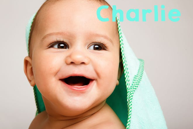 Baby smiling wearing green hooded toweel. Text says Charlie