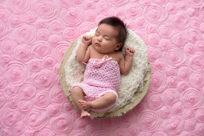 Baby girl sleeping in pink