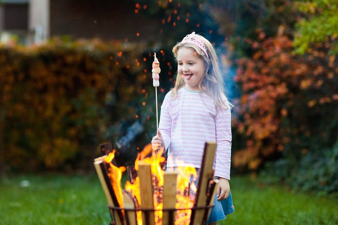 Girl roasting marshmallows