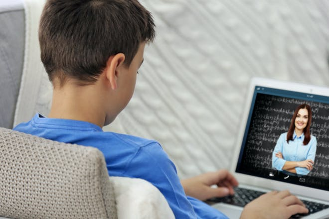 Boy learning on laptop