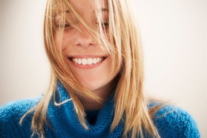 woman in blue jumper smiling