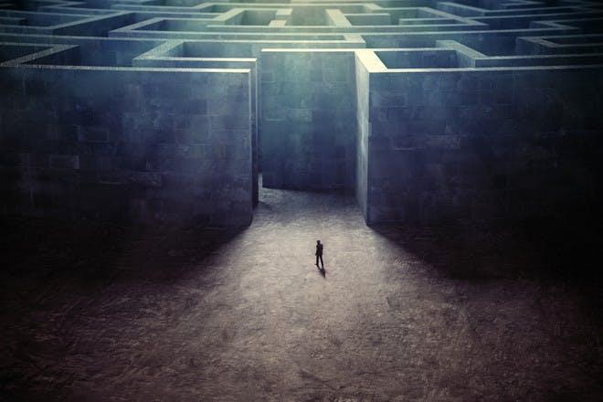 tiny person in maze