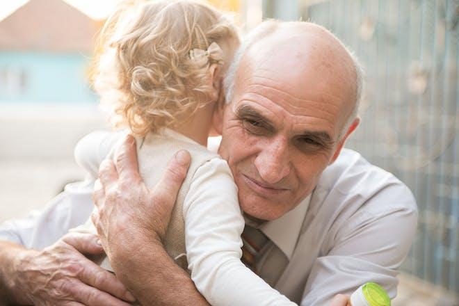 Grandad hugging little girl