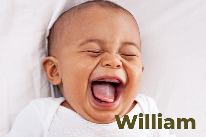 Baby lying down and laughing. Name William written in text