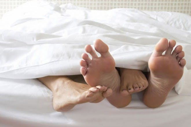 bare feet in bed