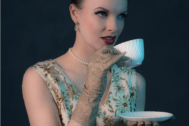 woman in 50s dress with teacup