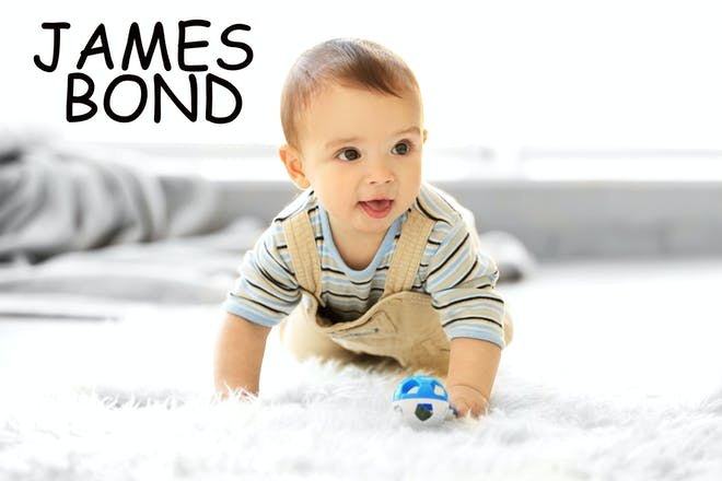 A baby crawling, with the name James Bond written in text