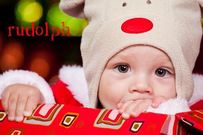baby in reindeer hat