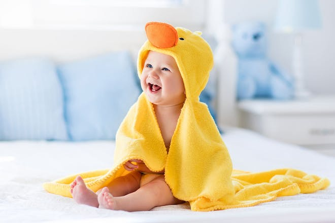 baby in hooded towel that looks like a duck