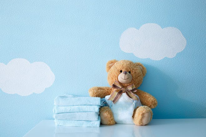 Baby nappies and teddy bear