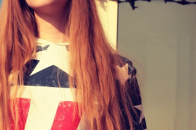 woman wearing red, white and blue shirt