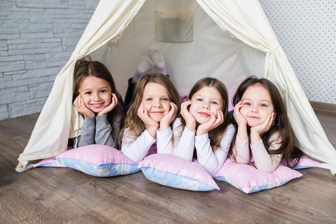 four girls friends in tepee