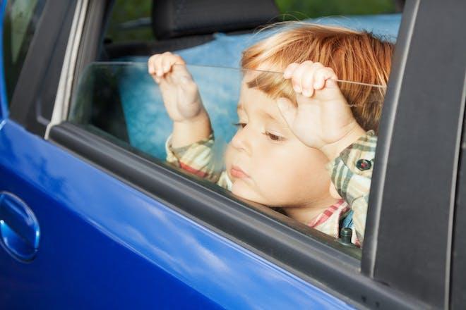 Nostalgic holidays child bored in the car