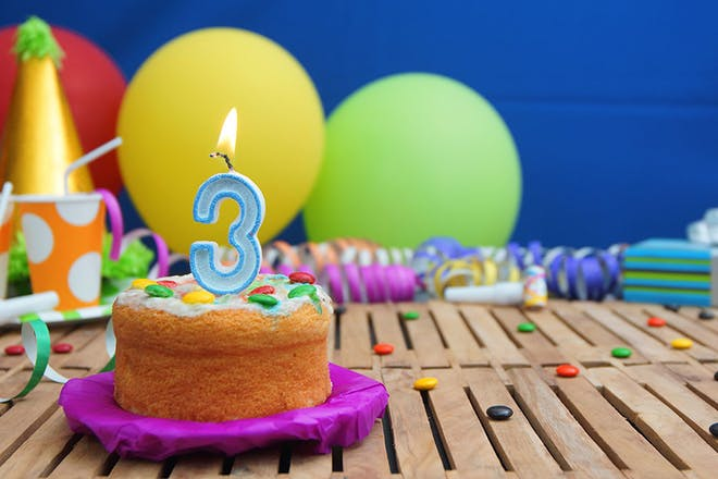 3-year-old birthday cake and balloons