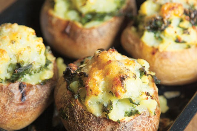Baked potatoes with cheesy kale