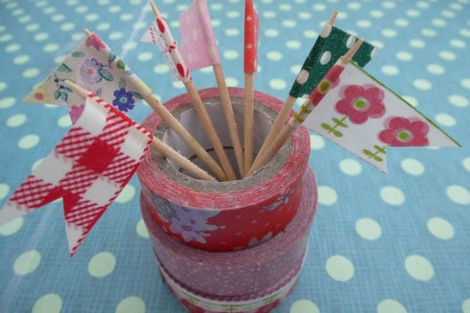 colourful washi mini flags on patterned background