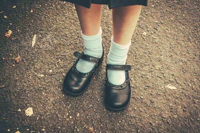 Girl's feet in school shoes