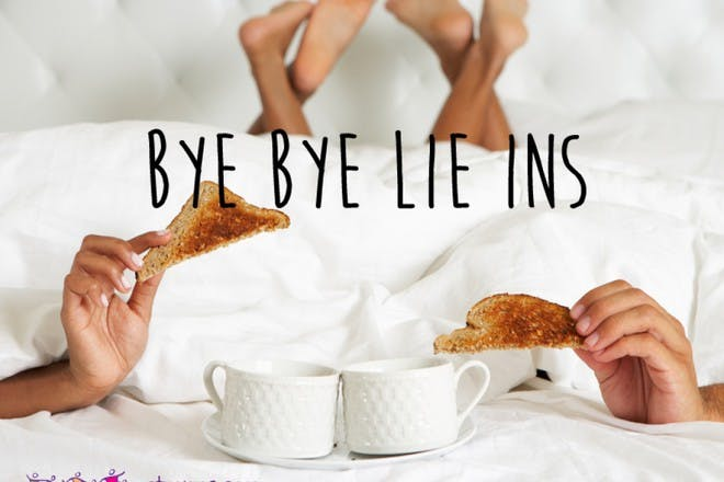woman having coffee and toast in bed