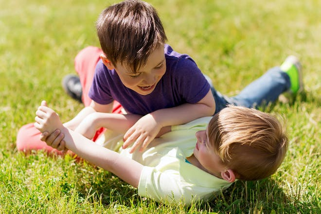 two boys play fighting