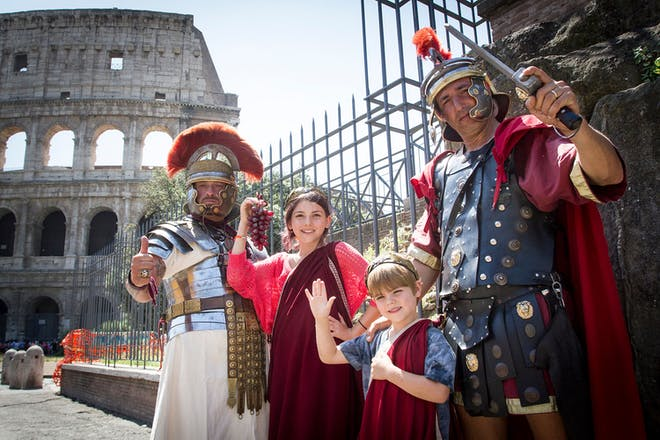 Two men and two children dressed as ancient Romans at the colliseum
