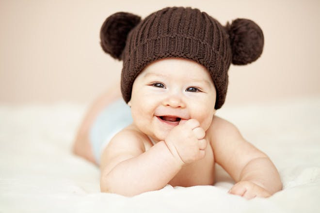 Baby with brown hat