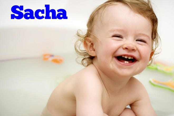 baby in bath laughing
